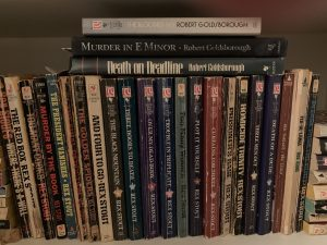 Here are a few of the Nero Wolfe books on my hall shelf